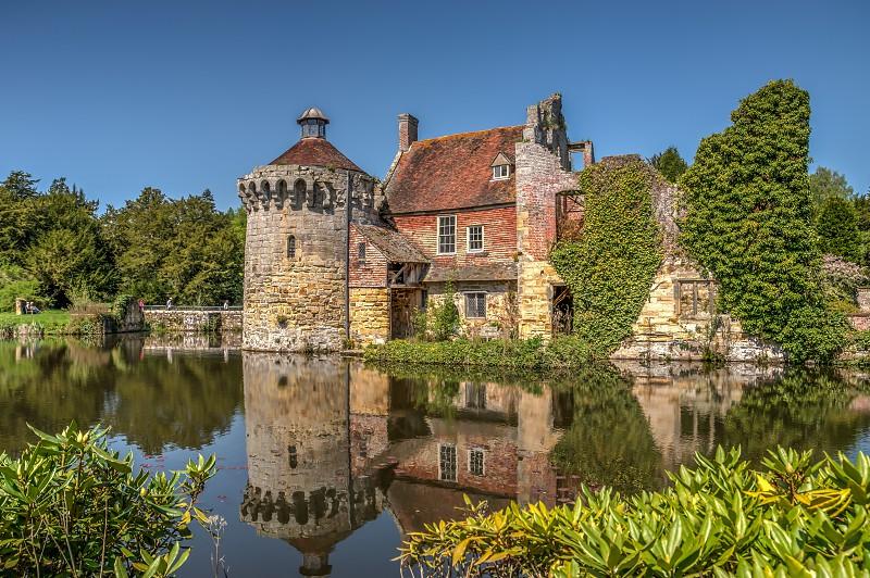 Scotney Castle and moat reflection High Dynamic Range image photo