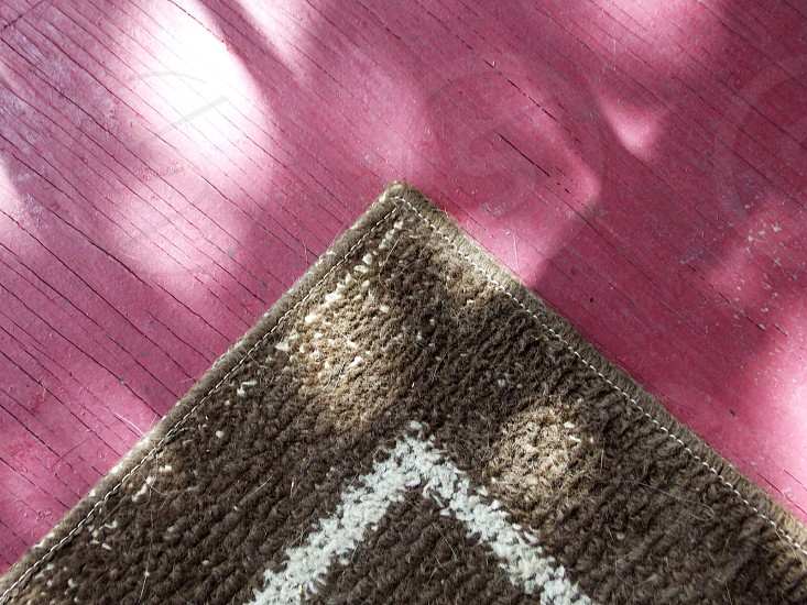 brown and white area rug photo