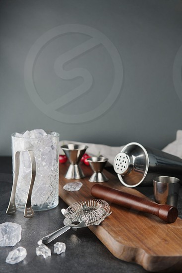 lifestyle product photography of barware shot on wood cutting board and neutral textures photo