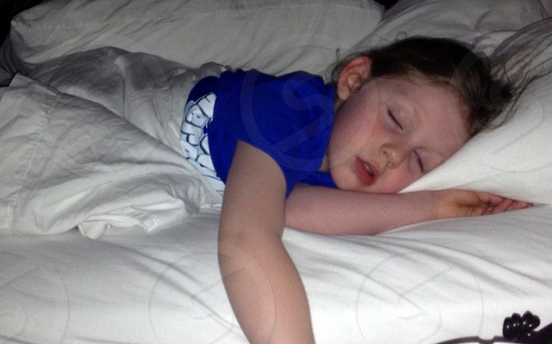 Sleeping child in bed photo