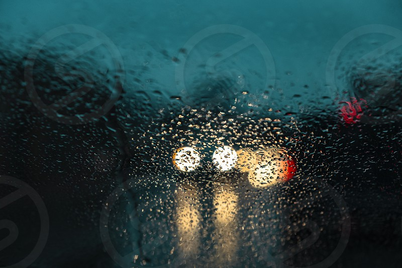 Headlights through rain on moody night. photo