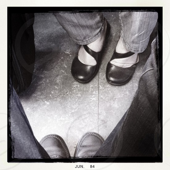 Strangers feet in the train . Traveling . Shoes.  photo