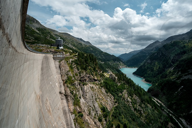 huge dam in the Austrian Maltatal with mountains river and see around. Recommended adventure Destination in the middle of austria. photo