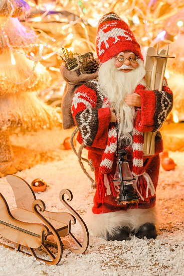 Modern figurine Santa Claus for Christmas Cards with selective focus photo