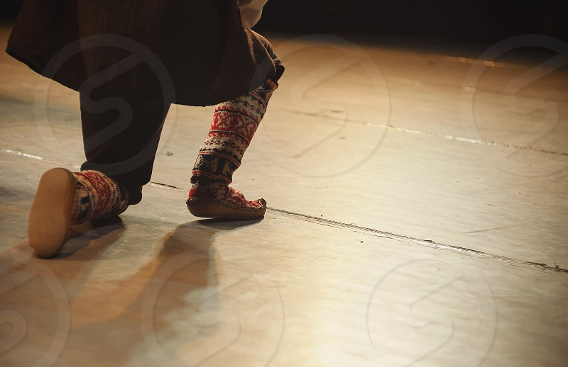 Details of dancer's legs dressed in traditional Serbian dress playing on stage. photo