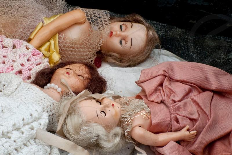 Three dolls in a junk shop. photo