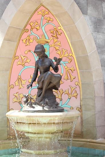 Cinderella statue fountain at daytime photo