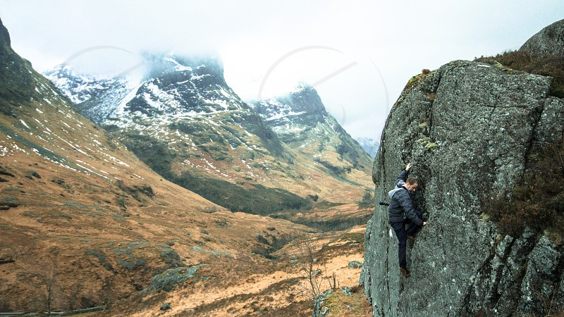 My photography partner Andrew Scaling the heights in mighty Glencoe just to get a different angle on his shot. Stunning backdrop to his brave attempt. photo
