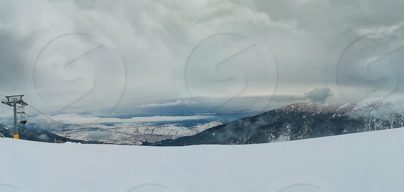 Bansko resort panoramic view with ski slope view from the top of the mountain Bulgaria. photo