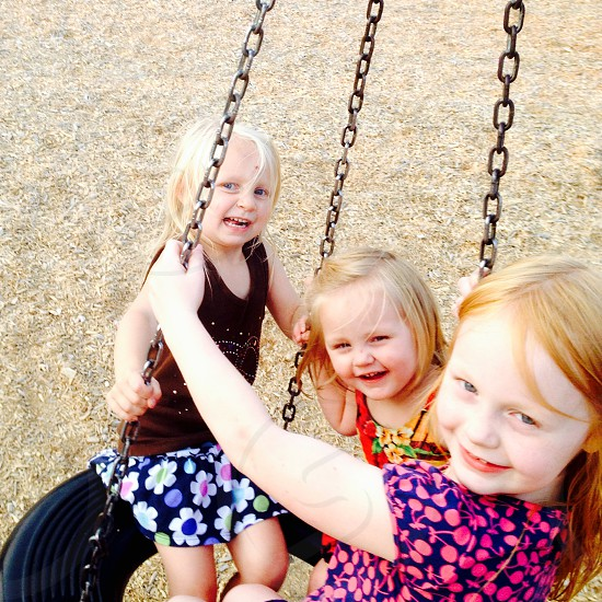 Outside fun tire swing playground sisters friends photo