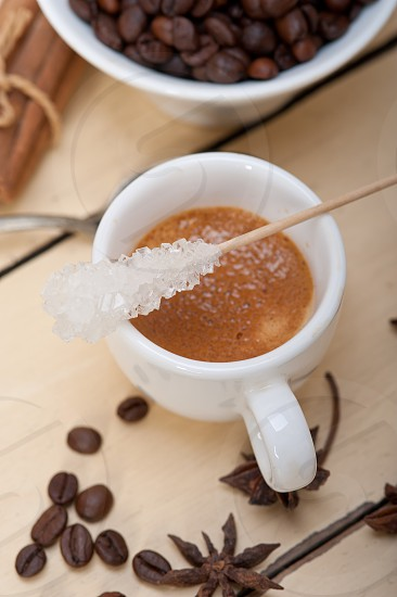 espresso coffee  over white wood rustic table  with sugar and spice photo