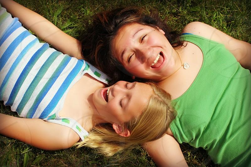 best friends summer fun silly girls blond brunette tween outdoor photo