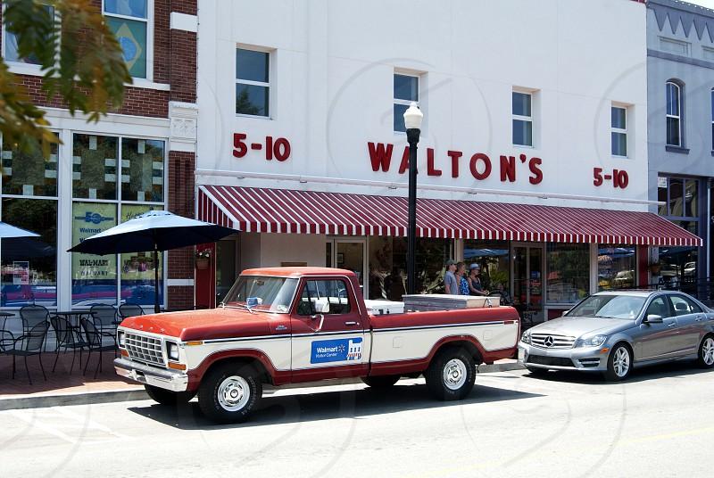 Exterior of Walton's 5&10 in Bentonville with Sam Walton's truck photo