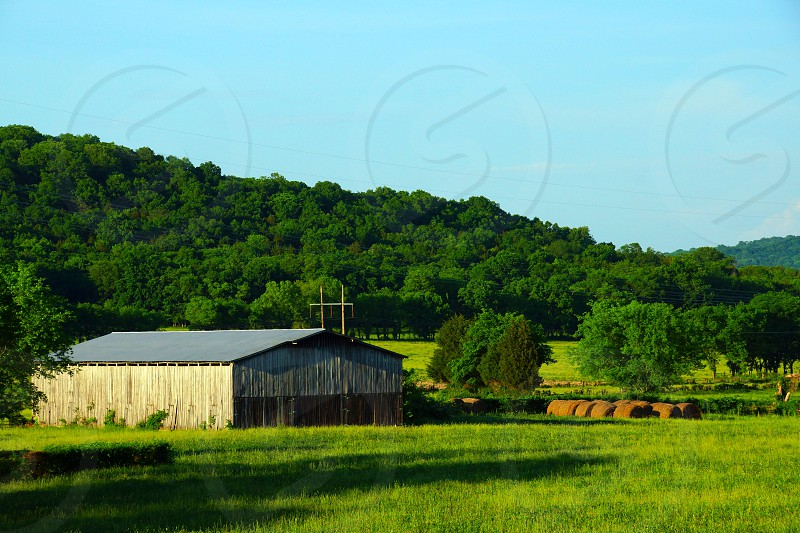 brown and grey barn in the field photo