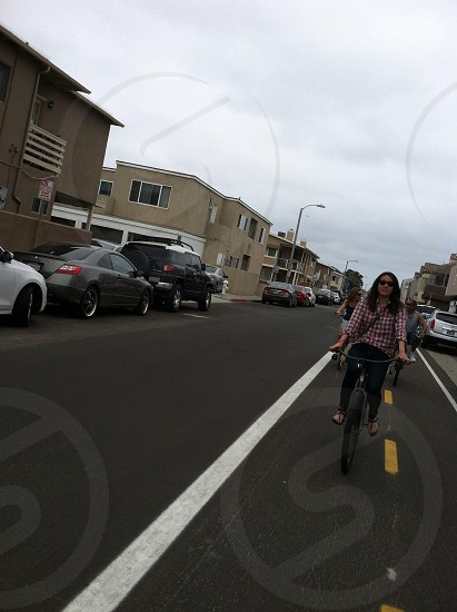 woman in blue denim skinny jeans riding a bicycle photo