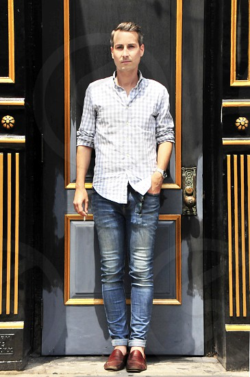 street fashion new york city fashion jeans preppy chic door preppy button down shirt male model photo