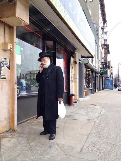 man wearing a  black coat photo