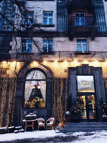 Street city lights winter snow architecture building hotel luxury life Kiev Ukraine trees nature day walk cafe  photo