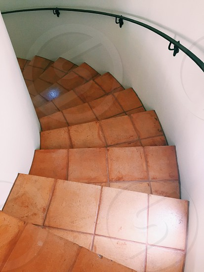 going down curve stairs photo