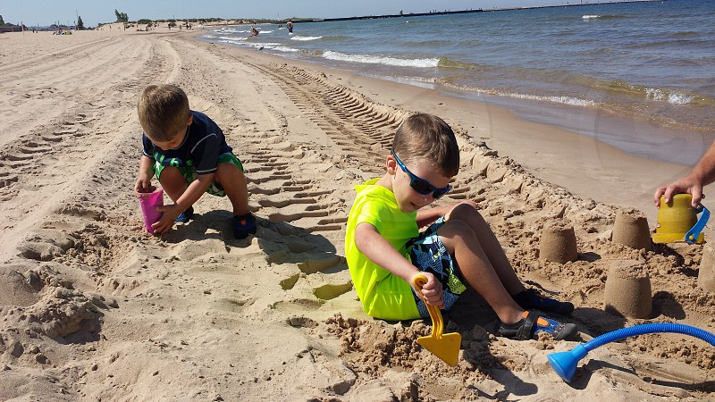 Kids playing in sand  photo