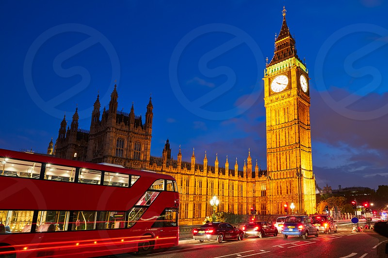 Big Ben Clock Tower with London Bus sunset in England photo