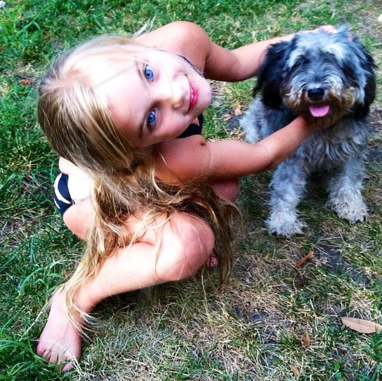 My sister-in-law's daughter with her dog Charlie photo