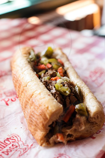 Hot Dog french fries Italian beef sandwich shot at Portillo's in Chicago. photo