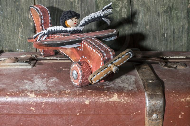 Vintage children's wooden toy airplane and manikin.  photo
