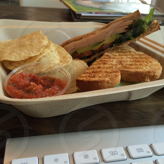 Lunch sandwich salsa chips desk working lunch take out photo