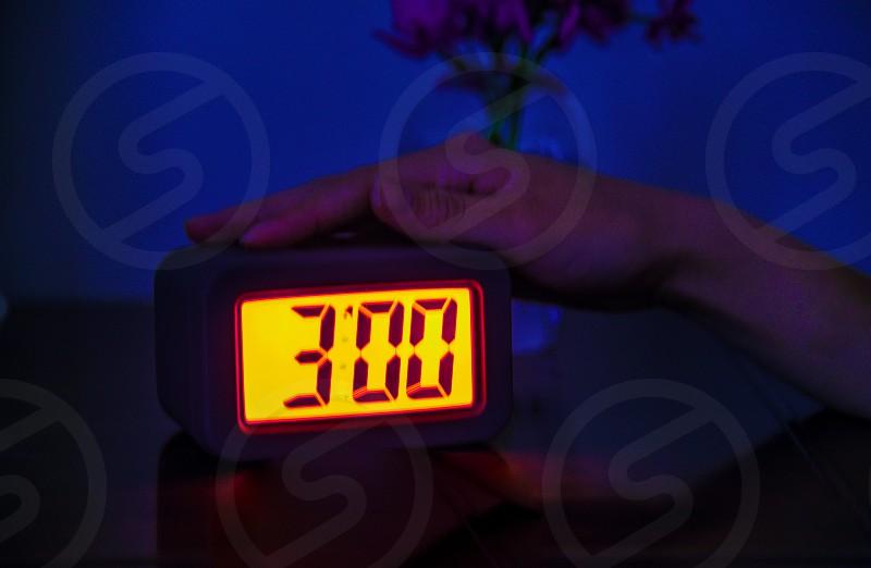 digital alarm clock at 3:00 photo