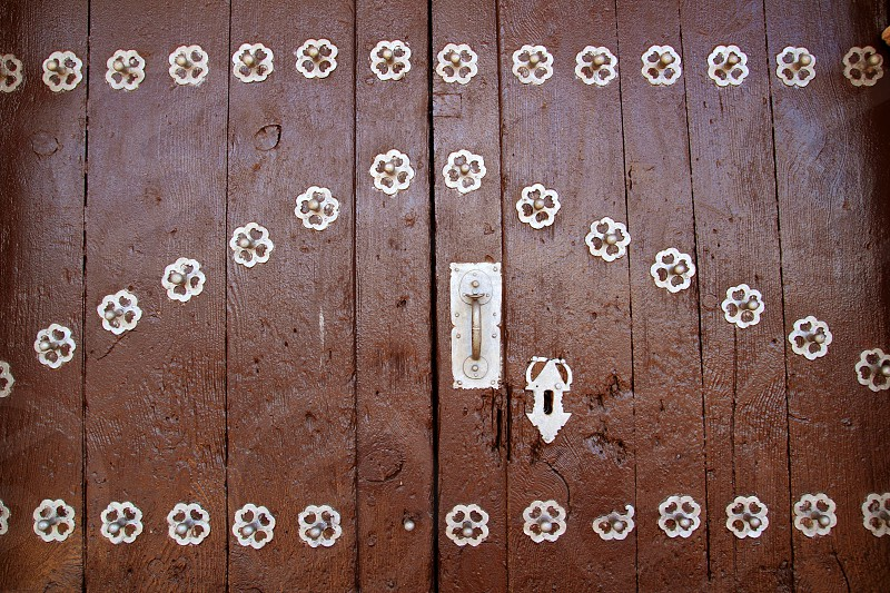 Anciend wood door with metal silver decoration rustic photo
