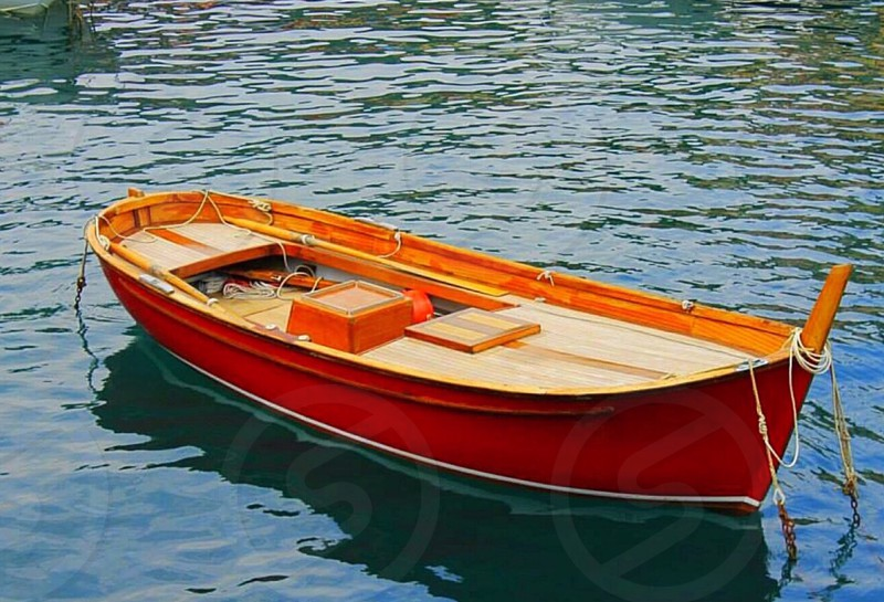 Red Boat on Water photo