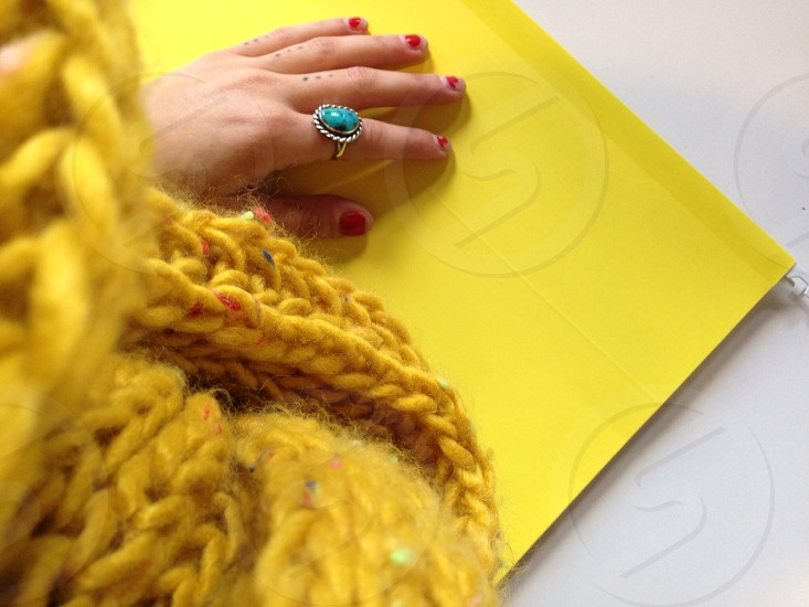 woman in chunky gold scarf and silver turquoise ring photo