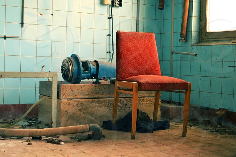 Red chair abandoned photo labratory VEB Fotowerke Steglitz  photo