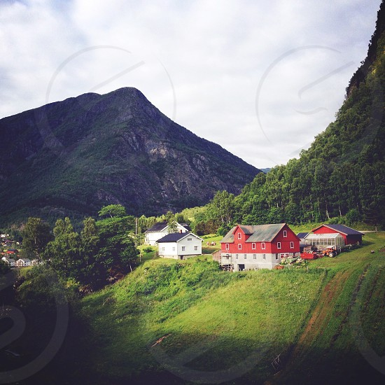 red and grey barn near mountain  photo