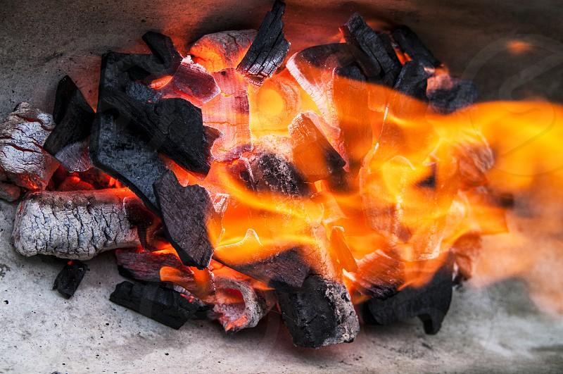 charcoal burning firewood burn wood fire flame bonfire nobody no people horizontal photo