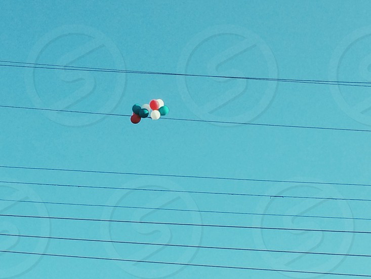 assorted-color balloon on sky photo