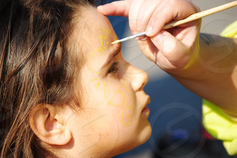 painting on girl's face photo
