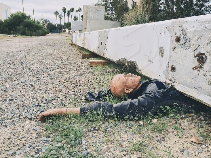 human dummy under sewage photo
