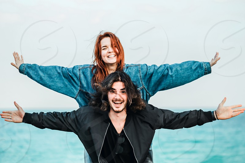 Happy romantic couple in love having fun on the beach on a spring day beauty of nature happiness concept photo