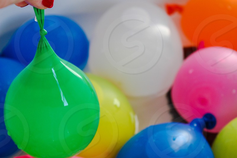 Water balloons in a tub. photo