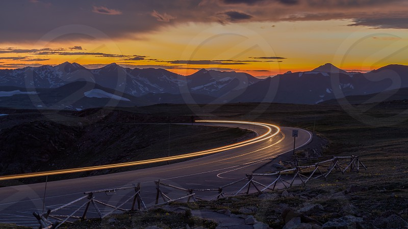 Light trails at sunset in the Rocky Mountains photo