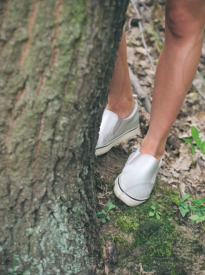 Woman in Forest Hiding Behind the Tree Legs Closeup photo
