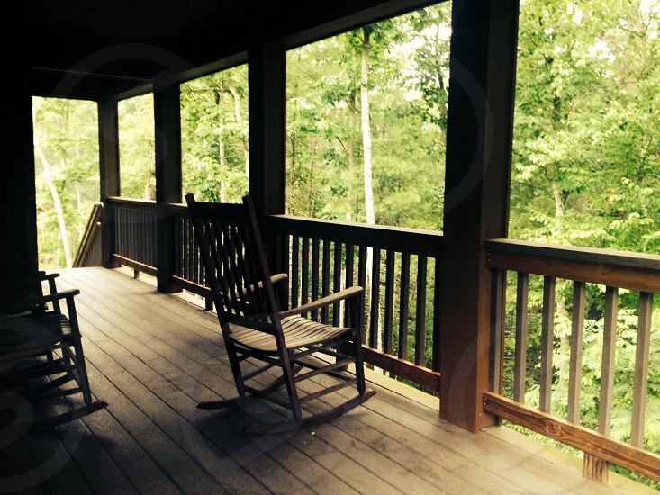 brown wooden rocking chair photo