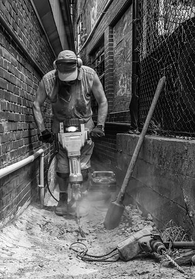 Construction Worker Jack Hammer Post Hole Digger SDS Hammer Leading Lines  photo