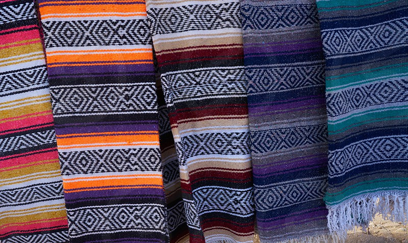 Mexican serape blanket in a row at Mexico outdoor shop photo