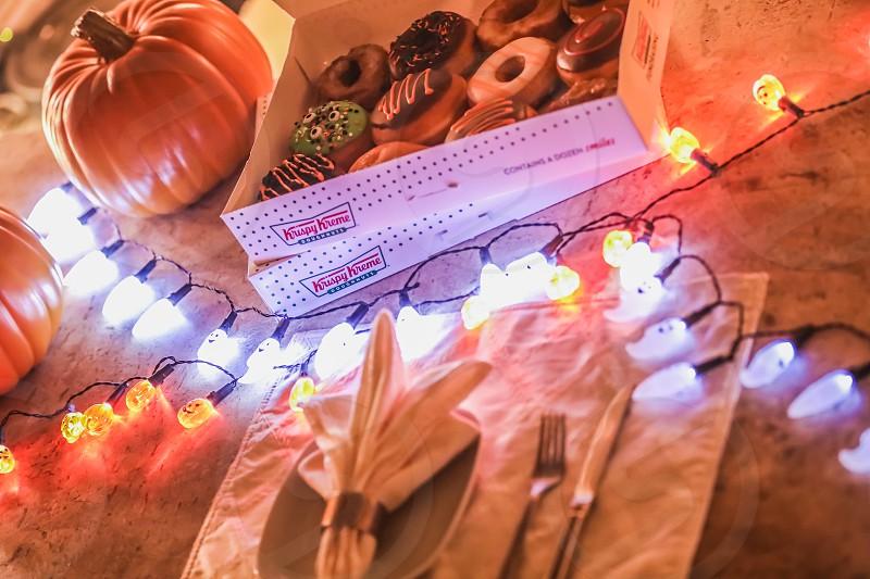 halloweendonutsdoughnutsdoughnutsweetlightlightstablepartyorangeholidaydecortable settingpumpkinghost photo