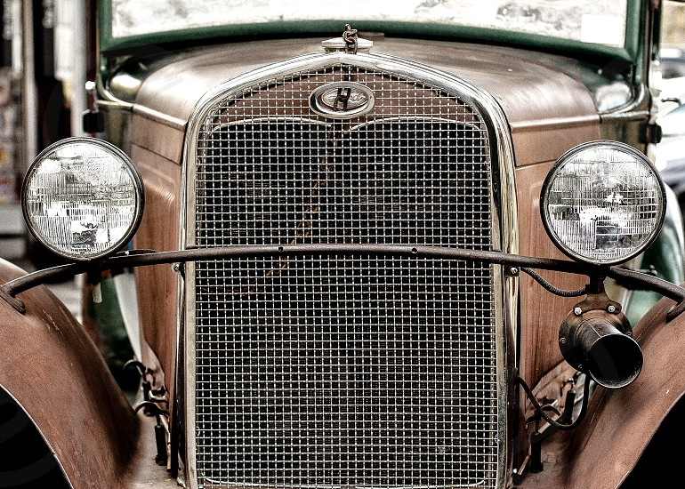 Old rusty Ford.  Automobile vintage car vintage Ford photo