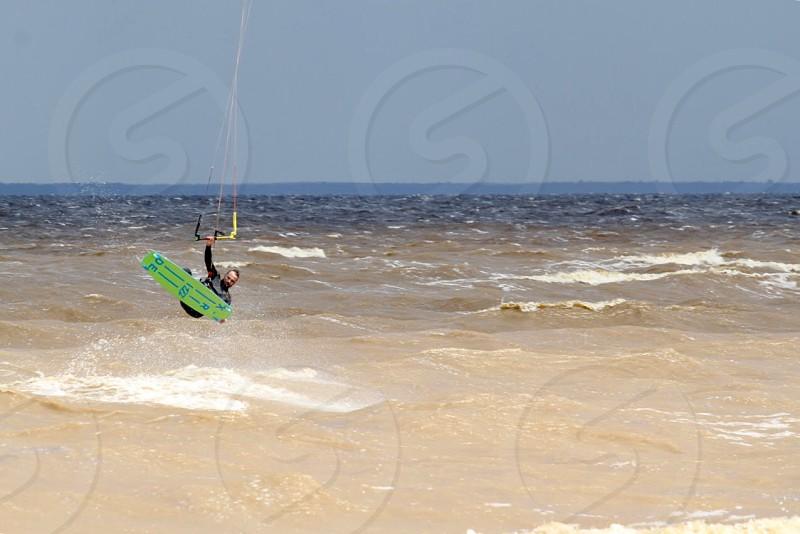 Tiny people sea Cyprus water bug place kitesurfing photo