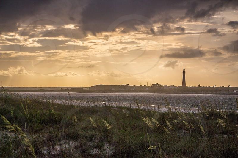 sunset lighthouse ponce inlet port orange dunes beach  photo
